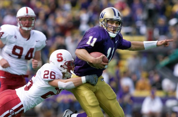 1999 P-I SSY Marques Tuiasosopo rushing for a first down during the second quarter of UW's victory over Stanford. (Dan DeLong/Seattle Post-Intelligencer)