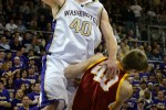 2008 winner Jon Brockman drives over USC's Greg Gaudino on the way to the basket in the game won by the UW over USC 87-73. (Scott Eklund/Seattle Post-Intelligencer)