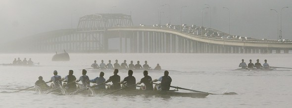 2010 nominee the UW mens' crew team practice on Lake Washington in the early morning as commuters drive over the Evergreen Point Bridge.( Dan DeLong/Seattle Post-Intelligencer)