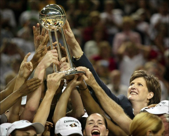 2004 SSY winner Seattle Storm Coach Anne Donovan reaches out to touch the championship trophy in 2004 as she became the first woman head coach to win the WNBA title. (Scott Eklund/Seattle Post-Intelligencer)