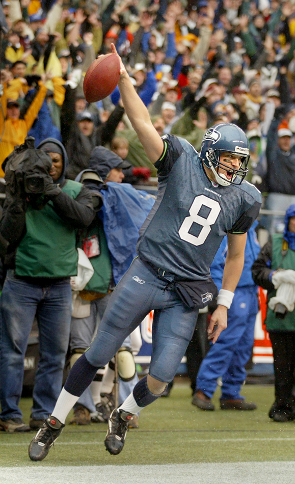 2003 SSY winner quarterback Matt Hasselbeck celebrates his third quarter touchdown on a six yard run to put the Seahawks ahead 14-3 during the Seattle 20-10 over the Washington Redskins in the NFC Divisional Playoff game (Scott Eklund/Seattle Post-Intelligencer)