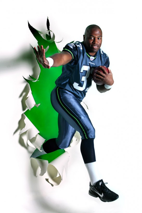 The 2005 Sports Star of the Year was Seahawks running back Shawn Alexander, photographed breaking out of the newspaper for a P-I season-opening special section in 2007. (Andy Rogers/Seattle Post-Intelligencer)