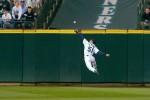2001 winner Ichiro Suzuki runs down a fly ball against the Atlanta Braves' Robert Fick. (Scott Eklund/Seattle Post-Intelligencer)