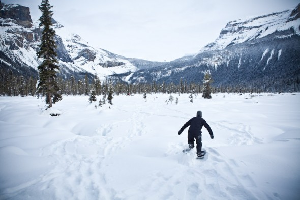 A wedding guest tromps through the snow covering Lake Louise in his snow shoes. (Photo by Andy Rogers/Red Box Pictures)
