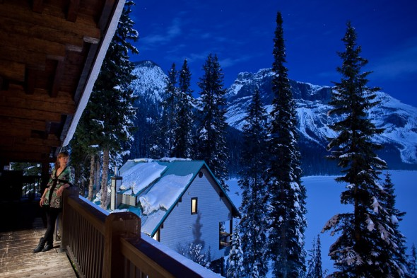 A guest enjoys the beauty of the full moon over Lake Louise at the Emerald Lake Lodge. (Photo by Andy Rogers/Red Box Pictures)