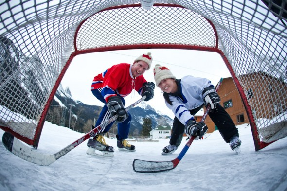 Karen and Steve, the bride and groom, play hockey on an outdoor rink in Field, B.C. the day before their wedding. (Photo by Andy Rogers/Red Box Pictures)