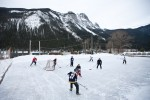 Steve, Karen and their guests play hockey on an outdoor rink in Field, B.C. (Photography by Scott Eklund/Red Box Pictures)