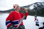 Steve takes a swig of Maker's Mark to help keep warm during an outdoor hockey game in Field, B.C. (Photography by Scott Eklund/Red Box Pictures)