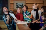 Karen and guests sing karaoke to live piano at the Emerald Lake Lodge. (Photography by Scott Eklund/Red Box Pictures)