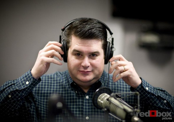 DJ Greg Lowder adjusts his headset as he begins his first show on Nearlywed Radio. (Photography by Scott Eklund/Red Box Pictures)