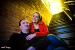 During their old Ballard engagement portrait, Brian and Tara sit in an apartment stairwell. (Photography by Andy Rogers/Red Box Pictures)