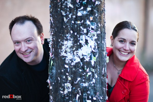 Tara and Brian with an flyerless telephone pole in old Ballard during their Seattle engagement session. (Photography by Andy Rogers/Red Box Pictures)