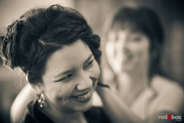Sarah has her hair touched up by a brides maid prior to her wedding at the Lake Union Cafe in Seattle. (Photo by Andy Rogers/Red Box Pictures)