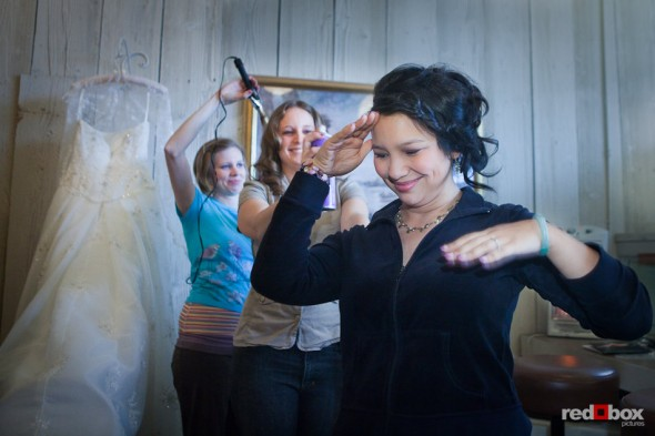 In the bride's room at the Lake Union Cafe, Sarah's bridesmaid applies hair spray prior to her wedding in Seattle. (Photo by Rob Sumner/Red Box Pictures)