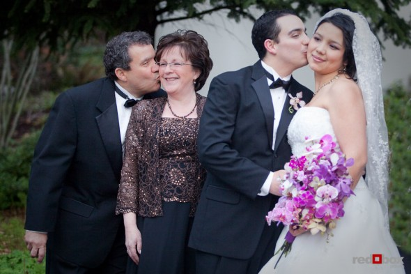 Kris' kisses Sarah as his father kisses his mother while taking portraits outside the Lake Union Cafe in Seattle. (Photo by Rob Sumner/Red Box Pictures)