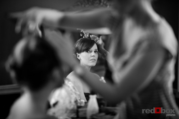 The bride has her hair done at the Bacon Mansion prior to the wedding in Seattle. Scott Eklund/Red Box Pictures/Photography