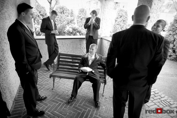The groom and groomsmen wait prior to the start of the wedding at the Bacon Mansion on Capitol Hill in Seattle. Wedding Photography By Scott Eklund/Red Box Pictures