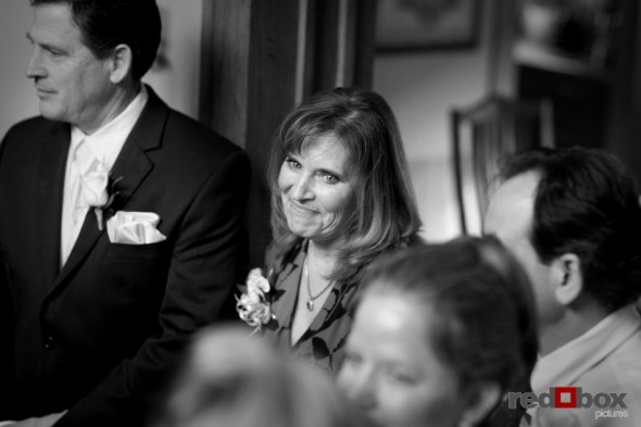 The mother of the groom smiles at her son prior to the wedding at the Bacon Mansion in Seattle on Capitol Hill. Photography: Scott Eklund/Red Box Pictures