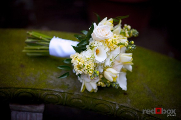 The Bride's bouquet rest on this bench at the Beacon Mansion in Seattle on Capitol Hill. Wedding Photography: Scott Eklund/Red Box Pictures