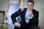 A portrait of the groom with the bride behind him before the wedding in Seattle on Capitol Hill at the Bacon Mansion. Wedding Photographer Scott Eklund Red Box Pictures