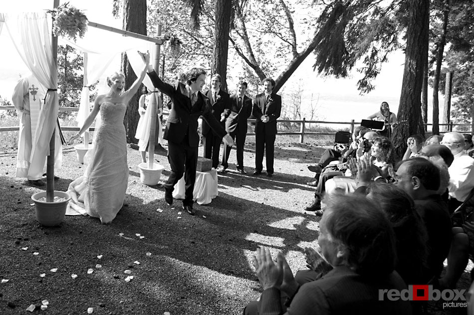 the bride and groom celebrate after the ceremony at kitsap memorial state park wedding in poulsbo