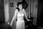 The bride is anxious and excited before her wedding at St. Louise Catholic Church in Bellevue. (Wedding Photographer Scott Eklund Red Box Pictures)
