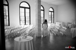 Kate takes a peek at the decor before her wedding at the Engine Room at Georgetown Studios in Seattle. (Photo by Dan DeLong/Red Box Pictures)