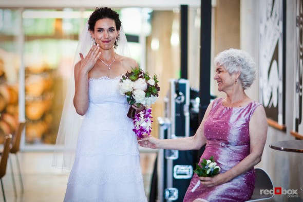 Laura becomes emotional as her mother look on before walking down the aisle to marry Nathan at the Novelty Hill Januik Winery in Woodinville, WA.