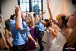 Guests dance to the tunes at Kate and Dan's wedding reception in the Georgetown Studios' Engine Room in Seattle. (Photography by Andy Rogers/Red Box Pictures)