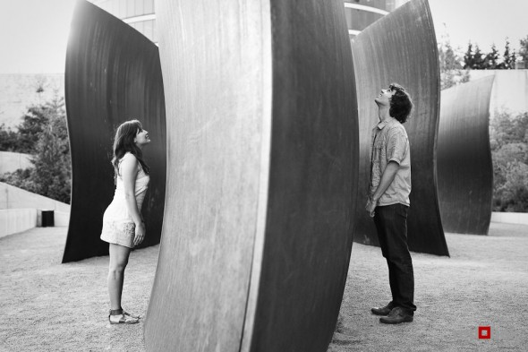 Anghi and Andy play amidst the art at Seattle Art Museum Sculpture Park while being photographed for their engagement. Photo by Dan DeLong/Red Box Pictures