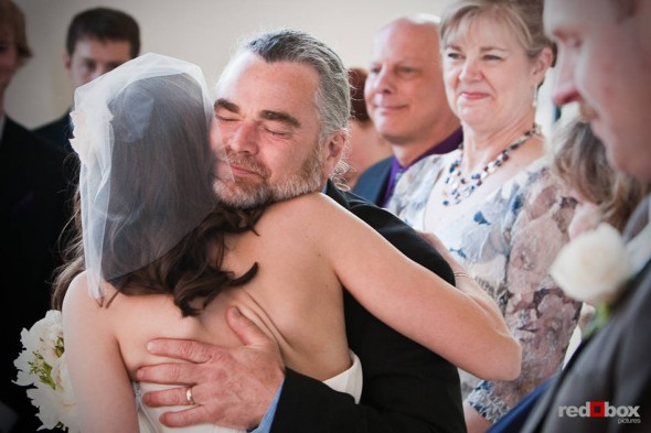 Kate hugs her father during her wedding to Dan at the Engine Room @ Georgetown Studios in Seattle. (Photography by Andy Rogers/Red Box Pictures)