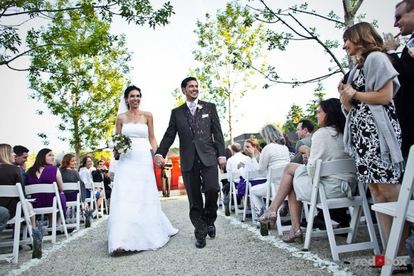 Laura and Nathan walk down the aisle after being married in the courtyard of the Novelty Hill Januik Winery in Woodinville, WA. (Photo by Dan DeLong/Red Box Pictures)