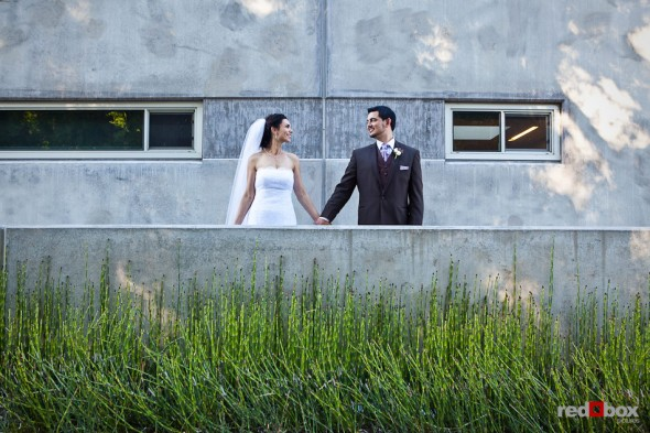 Bride Laura and groom Nathan pose outside the Novelty Hill Januik Winery in Woodinville before their wedding. (Photo by Dan DeLong/Red Box Pictures)