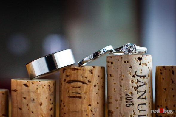 Laura and Nathan's wedding rings photographed during their reception at the Novelty Hill Januik Winery in Woodinville, WA. (Photo by Dan DeLong/Red Box Pictures)