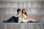 Anghi and Andy pose on steps during their engagement portrait session at Seattle Art Museum Sculpture Park. Photo by Dan DeLong/Red Box Pictures