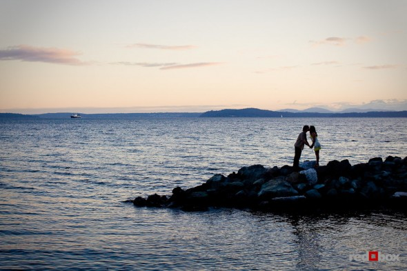 Anghi and Andy kiss at dusk in Myrtle Edwards Park in Seattle. The couple choose the park for their engagement pictures. Photo by Dan DeLong/Red Box Pictures