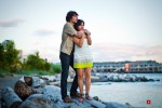 Anghi and Andy watch the sunset over the Puget Sound in Seattle while posing for their engagement pictures. Photo by Dan DeLong/Red Box Pictures
