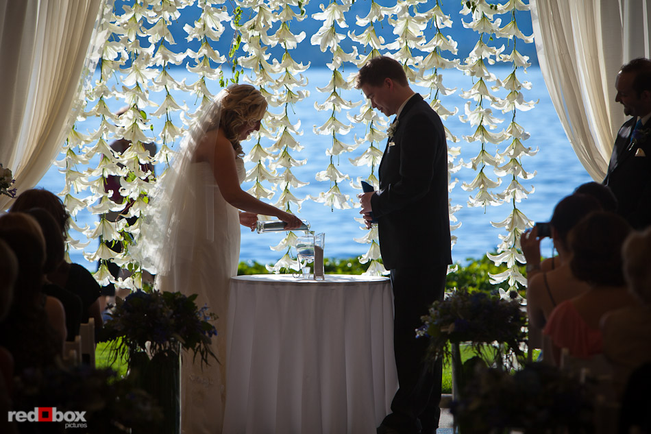 Rachel And Shawn Take Part In A Sand Ceremony During Their Wedding At The Woodmark Hotel