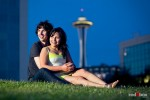 The Space Needle looms behind Anghi and Andy during their engagement photo shoot at Seattle's Myrtle Edwards Park. Photo by Dan DeLong/Red Box Pictures