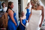 Rachel's bridesmaids help her bustle her dress prior to her wedding ceremony at the Woodmark Hotel in Kirkland, WA. (Photography by Andy Rogers/Red Box Pictures)