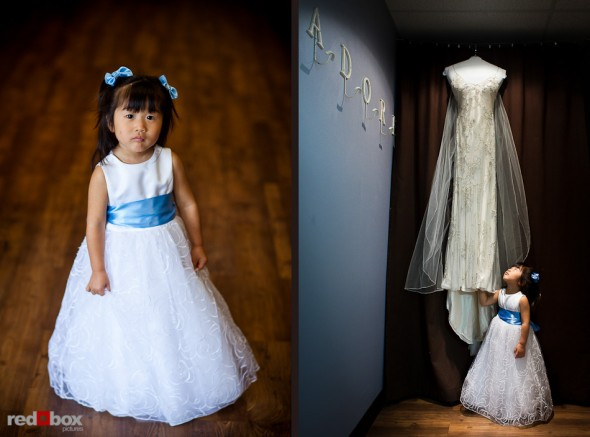 Nobuyo's niece and flower girl admires her wedding dress as the bride has hair and makeup done at Adore in Seattle prior to her wedding aboard the Virginia V. Photo by Seattle wedding photographer Andy Rogers of Red Box Pictures.