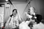 Nobuyo and Rory enjoy a toast by Rory's brother after their wedding aboard the Virginia V steamship on Lake Union in Seattle. (Photo by Dan DeLong/Red Box Pictures)