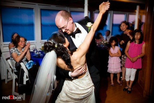 Nobuyo and Rory finish their first dance, a tango, as a married couple aboard the Virginia V steamship on Lake Union in Seattle. (Photo by Dan DeLong/Red Box Pictures)