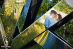 At the Seattle Art Museum's Olympic Sculpture Park, Katherine and Bryan are reflected in a sculpture during engagement photo session. (Photo by Dan DeLong/Red Box Pictures)