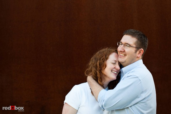 Katherine and Bryan hug during their engagement pictures at the Seattle Art Museum's Olympic Sculpture Park in Seattle. (Photo by Dan DeLong/Red Box Pictures)