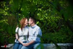 Katherine and Bryan kiss during their engagement photo session at the Seattle Art Museum's Olympic Sculpture Park in Seattle. (Photo by Dan DeLong/Red Box Pictures)
