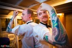 Rory (right) and his twin brother Ryan give in to requests that they show off matching dragon tattoos during Rory and Nobuyo's wedding reception aboard the Virginia V on Lake Union in Seattle. Photo by Seattle wedding photographer Andy Rogers of Red Box Pictures.