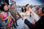 Nobuyo and Rory greet guests following their wedding ceremony aboard the Virginia V on Lake Union in Seattle. Photo by Seattle wedding photographer Andy Rogers of Red Box Pictures.