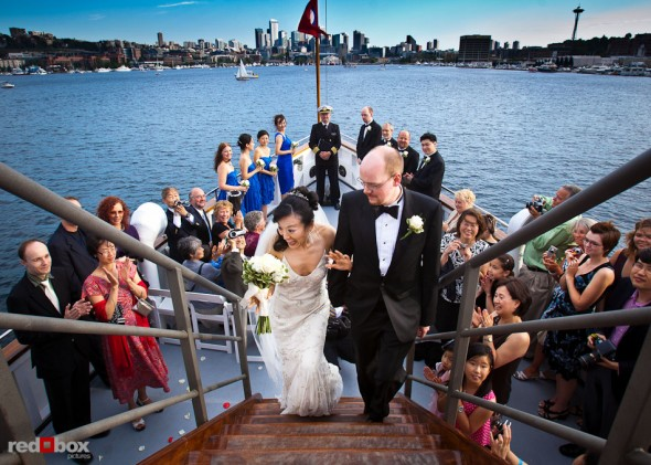 Nobuyo and Rory leave the deck following their wedding ceremony aboard the Virginia V on Lake Union in Seattle. Photo by Seattle wedding photographer Andy Rogers of Red Box Pictures.