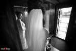 Nobuyo checks the mirror aboard the Virginia V prior to her wedding ceremony and recpetion. Photo by Seattle wedding photographer Andy Rogers of Red Box Pictures.